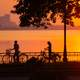 Sunset and 2 cyclists in Hanoi, Vietnam