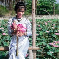 Bride in white and roses in Vietnam