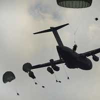 Airborne Paratroopers being dropped from a C-17