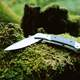 Folding Knife on a rock