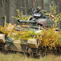Soldier commands a tank in combat
